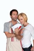 A couple jesting in kitchen — Stock Photo