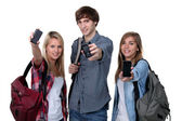 Three teenage students with backpacks and cellphones — Stock Photo