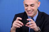 Businessman looking at his camera — Stock Photo