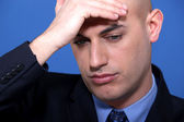 Businessman holding his head — Stock Photo