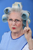 Old woman waving her finger in disapproval — Stock Photo