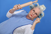 Angry old lady with rolling pin — Stock Photo