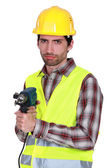 Portrait of a frowning tradesman — Stock Photo