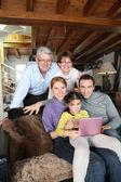 Family gathered around laptop — Stock Photo