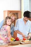 Family in their kitchen — Stock Photo