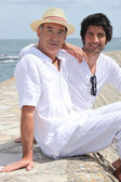 Two men on a pier — Stock Photo