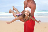 Man and child at the beach — Stock Photo