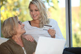 Mother and daughter shopping online — Stock Photo