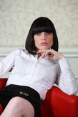Smart businesswoman alone in armchair — Stock Photo