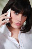 Sexy woman talking on the phone — Stock Photo