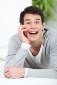 Shocked man at home — Stock Photo