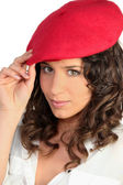 Brunette in a red beret — Stock Photo
