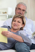 Mature couple relaxing on a couch — Stock Photo