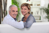 Friendly mature couple in a lounge — Stock Photo