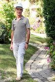 Senior man in a summer garden — Stock Photo