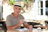 Senior having coffee outdoors — Stock Photo