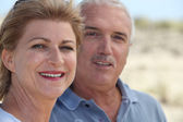 Mature couple at the beach — Stock Photo