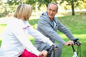Senior couple on a bike ride — Stock Photo