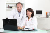 Two doctors in their office — Stock Photo