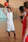 Basketball player shooting — Stock Photo