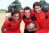 Três companheiros de equipe de futebol — Foto Stock