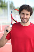 Tennis player holding racket — Stock Photo