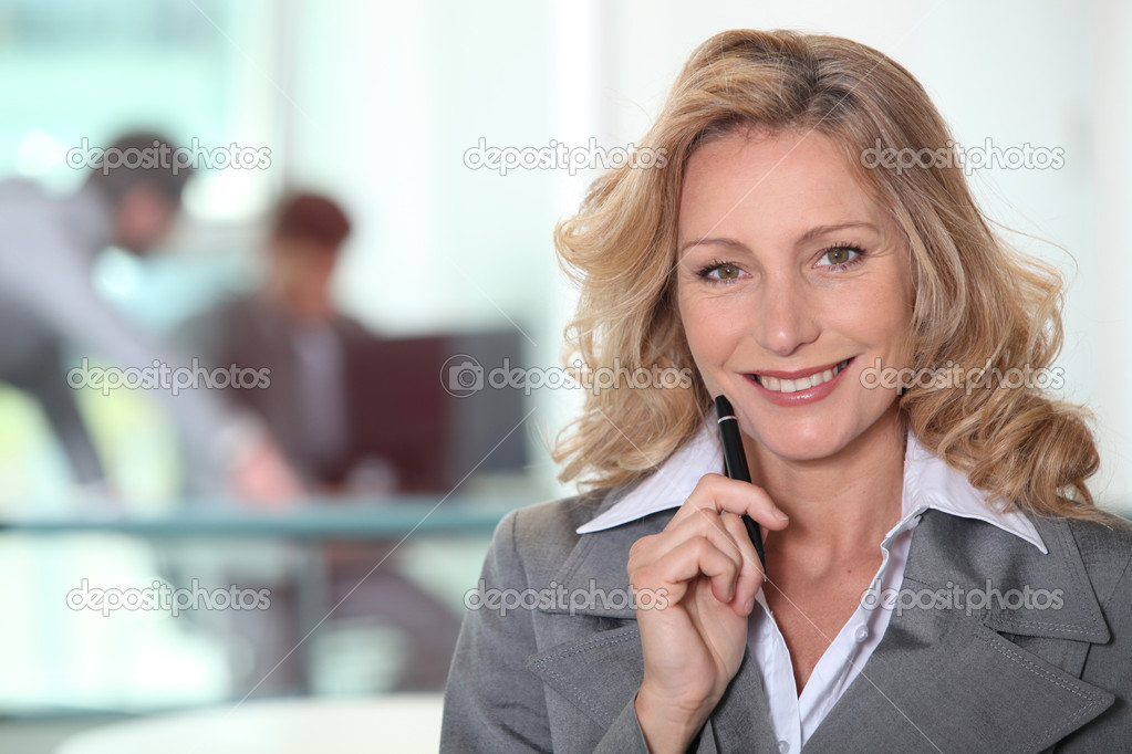 Portrait of mature woman in gray suit — Stock Photo #7934923