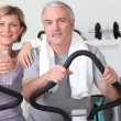 Stock Photo: Older couple at the gym