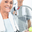 Couple playing tennis together - Foto Stock