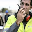 Foreman with a walkie talkie - Stock fotografie