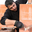 A bricklayer at work — Stock Photo #7941332