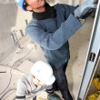 Two men installing dry-wall — Stock Photo #7941700