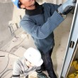 Two men installing dry-wall — Stock Photo