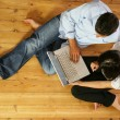 Couple in living-room with laptop computer, top-view — Stock Photo