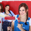 Stock Photo: Women painting a room red