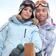 Couple enjoying skiing holiday — Stock Photo #7944071
