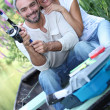 Man and woman fishing on the river — Stock Photo