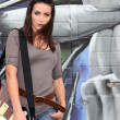 Foto Stock: Trendy female guitarist
