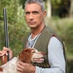Shooting man and dog — Stock Photo