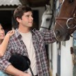 Young couple in a stable — Stock Photo
