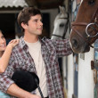 Stock Photo: Young couple in stable