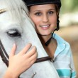 Stock Photo: Blond teenage horse rider