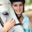 Blond teenage horse rider — Stock Photo #7945179