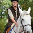 Young horsewoman with white horse — Stock fotografie
