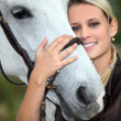 Woman and horse — Stock Photo #7945348
