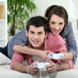 A couple of teenager playing video game. — Stock Photo #7945502