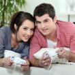 Stock Photo: Young couple playing video games together