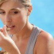 Blond woman eating cereals — Stock Photo
