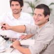 Stock Photo: Two young men having lunch