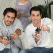 Stock Photo: Men playing video games